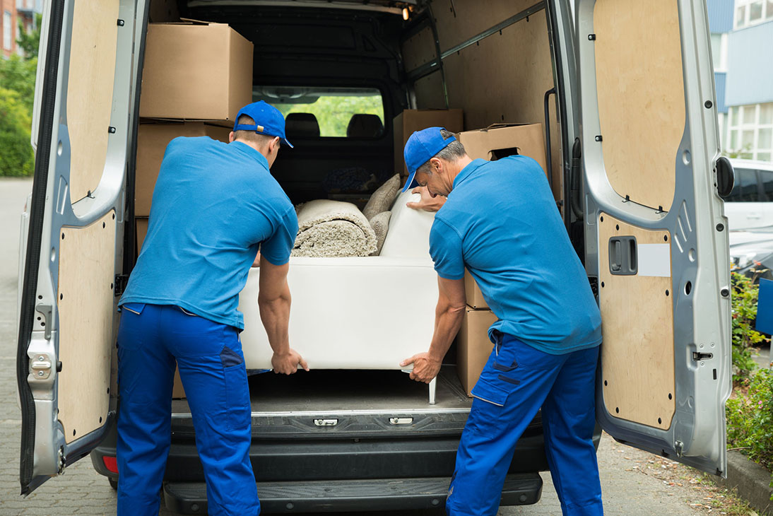 Two Workers Adjusting Sofa In Truck - Paris Débarras